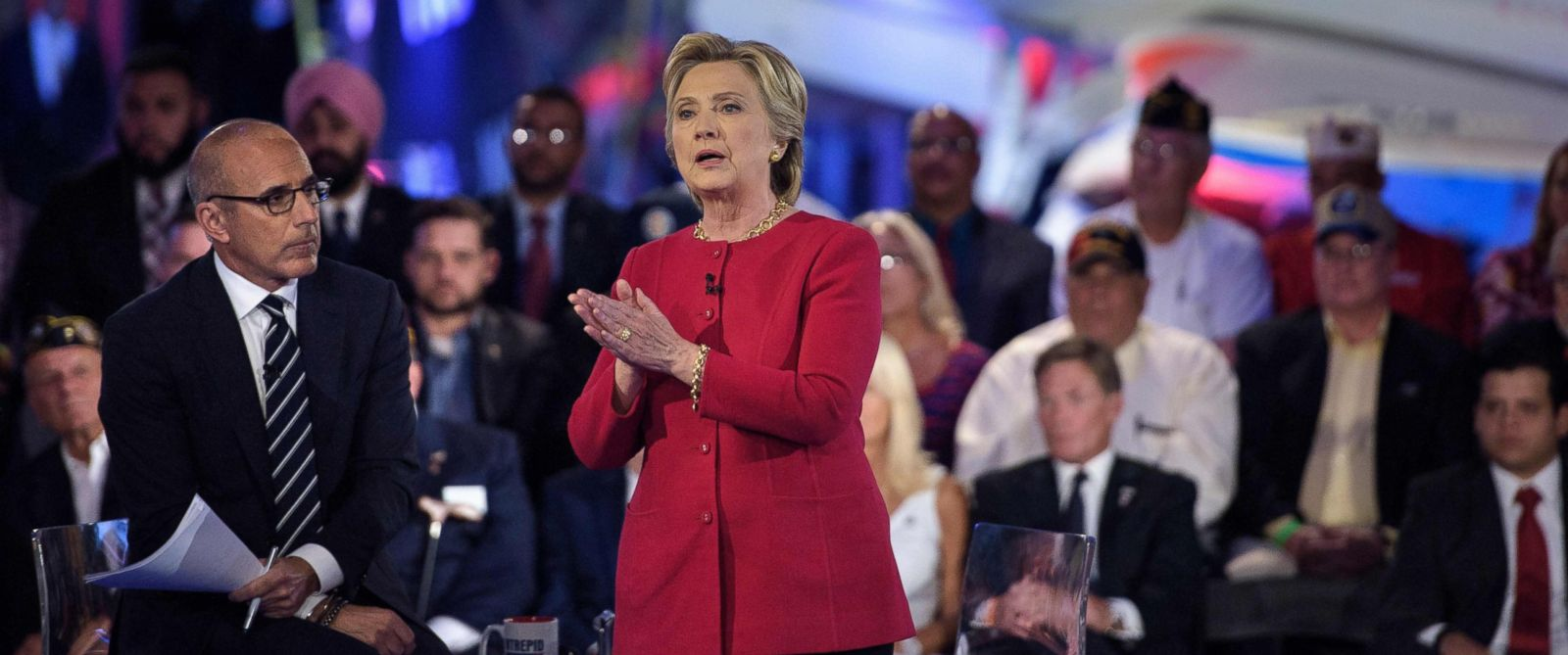 PHOTO: Matt Lauer listens as Democratic presidential nominee Hillary Clinton speaks during a veterans forum at the air and space museum aboard the aircraft carrier USS Intrepid on September 7, 2016 in New York, NY.