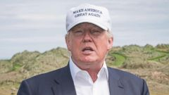 PHOTO: Presumptive Republican presidential nominee Donald Trump speaks to members of the media during a tour of his International Golf Links course north of Aberdeen on the east coast of Scotland on June 25, 2016.