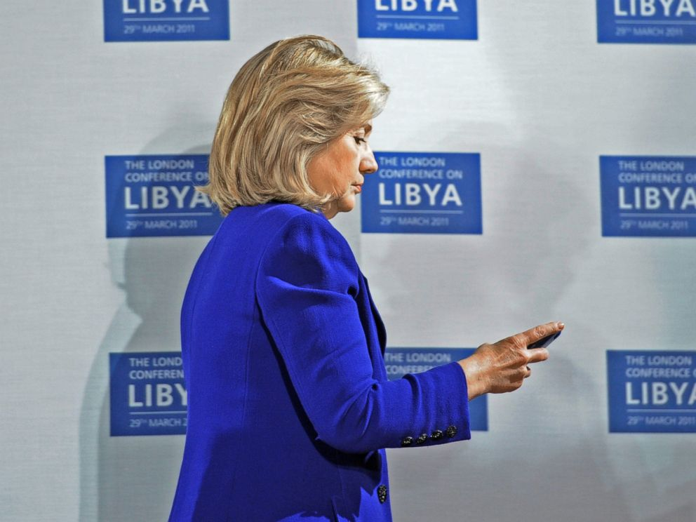 PHOTO: U.S. Secretary of State Hillary Clinton checks her phone at the opening of the Libyan Conference, a meeting of international allies to discuss the next steps for Libya, on March 29, 2011, in London.