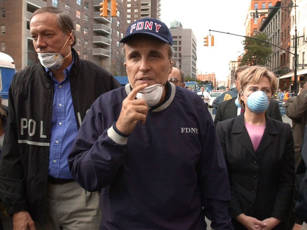 PHOTO:New York Governor George Pataki, left, New York City Mayor Rudolph Giuliani, center, and Senator Hillary Rodham Clinton, tour the site of the World Trade Center attacks on Sept. 12, 2001 in New York.