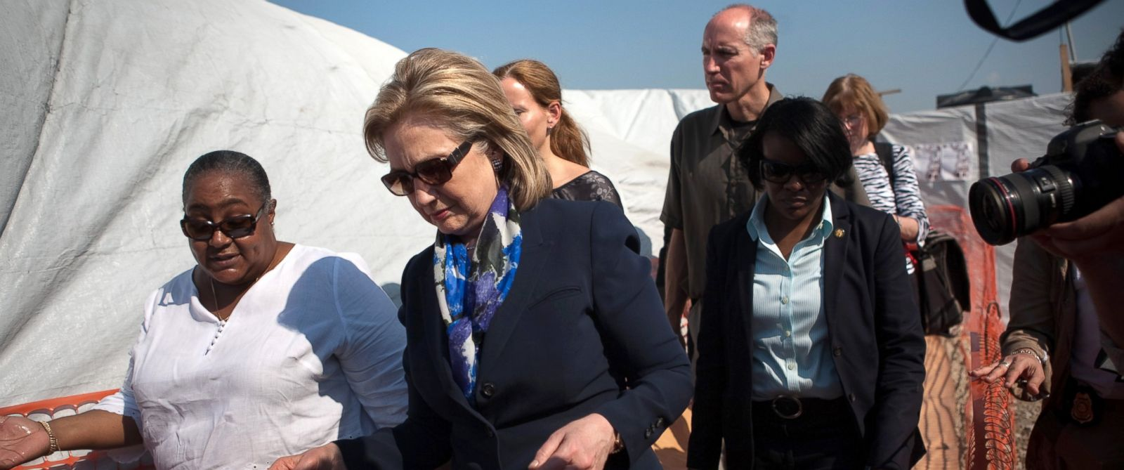 PHOTO: U.S. Secretary of State Hillary Clinton visits a cholera clinic run jointly by Partners in Health and the Haitian Red Cross within an IDP camp called La Piste, Jan. 30, 2011, in Port-au-Prince, Haiti.