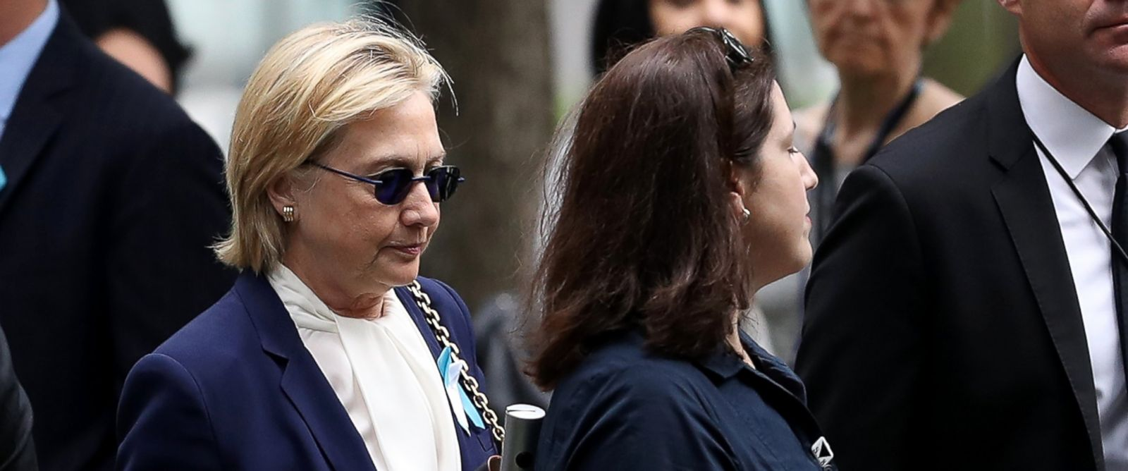 PHOTO: Democratic presidental nominee former Secretary of State Hillary Clinton arrives with an unidentified woman at the September 11 Commemoration Ceremony at the National September 11 Memorial & Museum, on Sept. 11, 2016, in New York City.