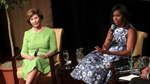 PHOTO: U.S. first lady Michelle Obama and former first lady Laura Bush participate in a discussion on the long tradition of America's First Ladies supporting troops, veterans, and military families, Sept. 16, 2016, at the National Archives in Washington.
