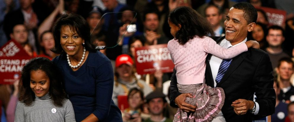 PHOTO: Barack Obama holds his youngest daughter Sasha with his wife Michelle and daughter Malia while thanking supporters for his victory in the Iowa caucus Jan. 3, 2008 in Des Moines, Iowa.