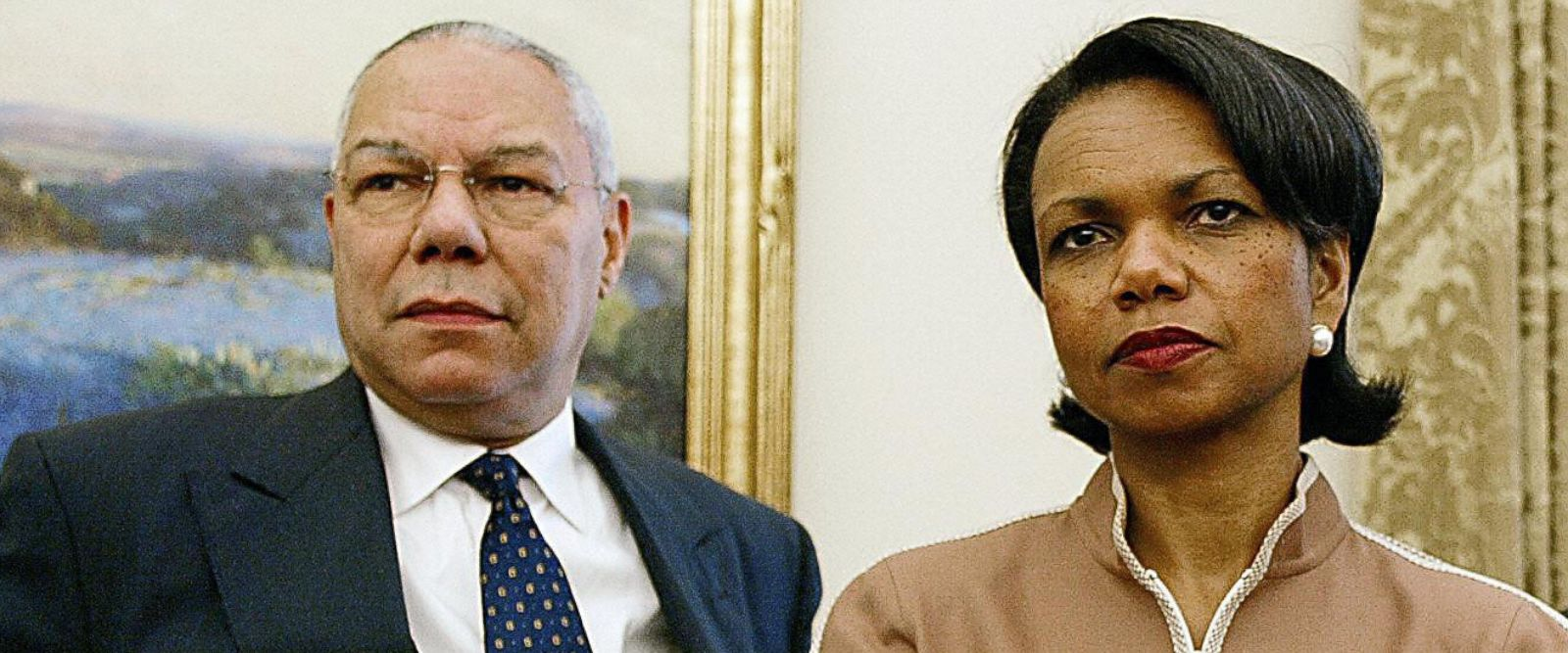 PHOTO: US Secretary of State Colin Powell and National Security Advisor Condoleezza Rice look on as US President George W. Bush meets with Chilean President Ricardo Lagos in the Oval Office of the White House 19 July 2004 in Washington, DC.