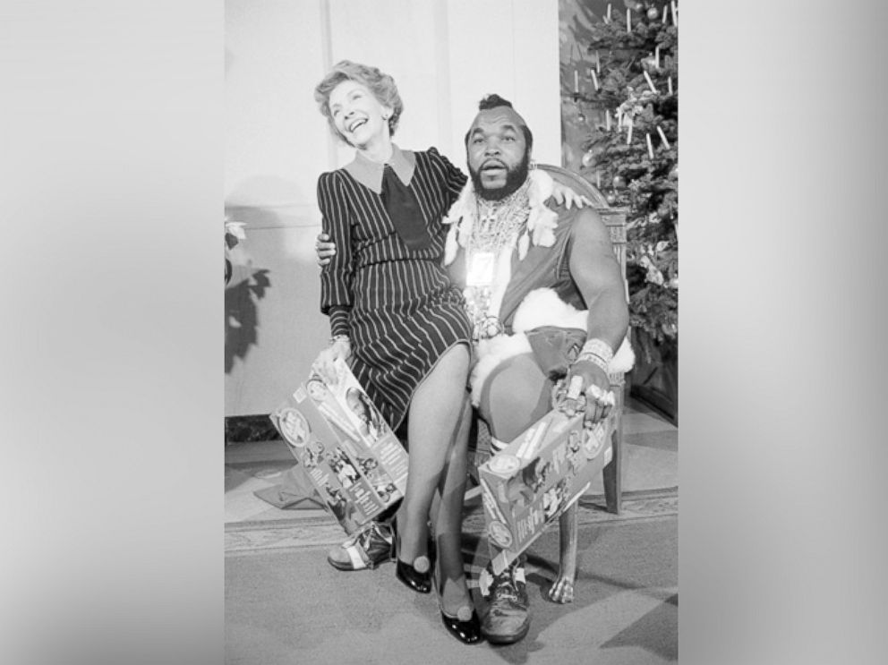 PHOTO: First Lady Nancy Reagan sits on the lap of television personality Mr. T. on Dec. 12, 1983 in Washington.