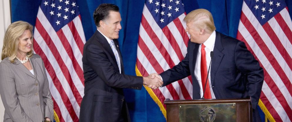 PHOTO: Republican presidential candidate Mitt Romney, center, shakes hands with Donald Trump after Trump endorsed Romneys presidential bid Feb. 2, 2012, at the Trump International Hotel in Las Vegas. Romneys wife, Ann is at left.