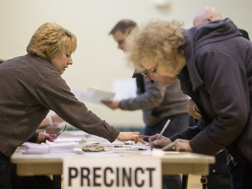 PHOTO: A poll worker instructs voters at a polling station in Warren, Mich., March 8, 2016.