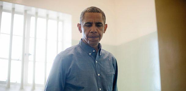 GTY barack obama robben island cell jt 130630 33x16 608 Obama Visits Mandelas Robben Island Cell