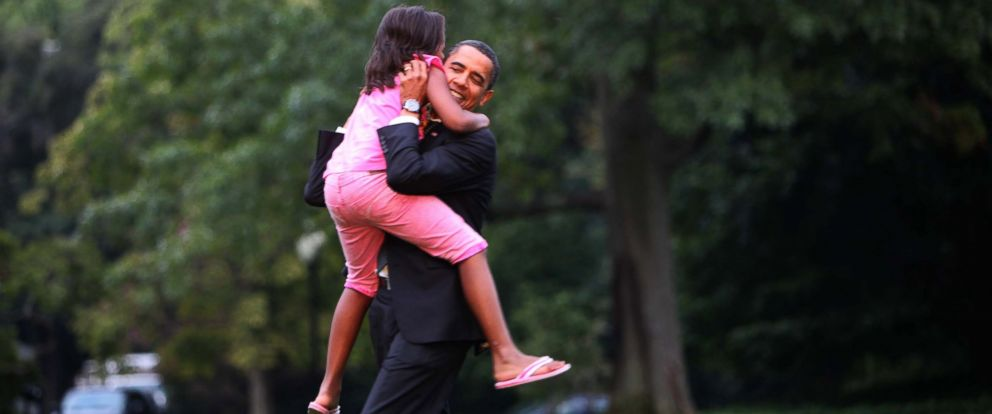 PHOTO: President Barack Obama is welcomed home by daughter Sasha on the South lawn of the White House in Washington, Sept. 15, 2009.