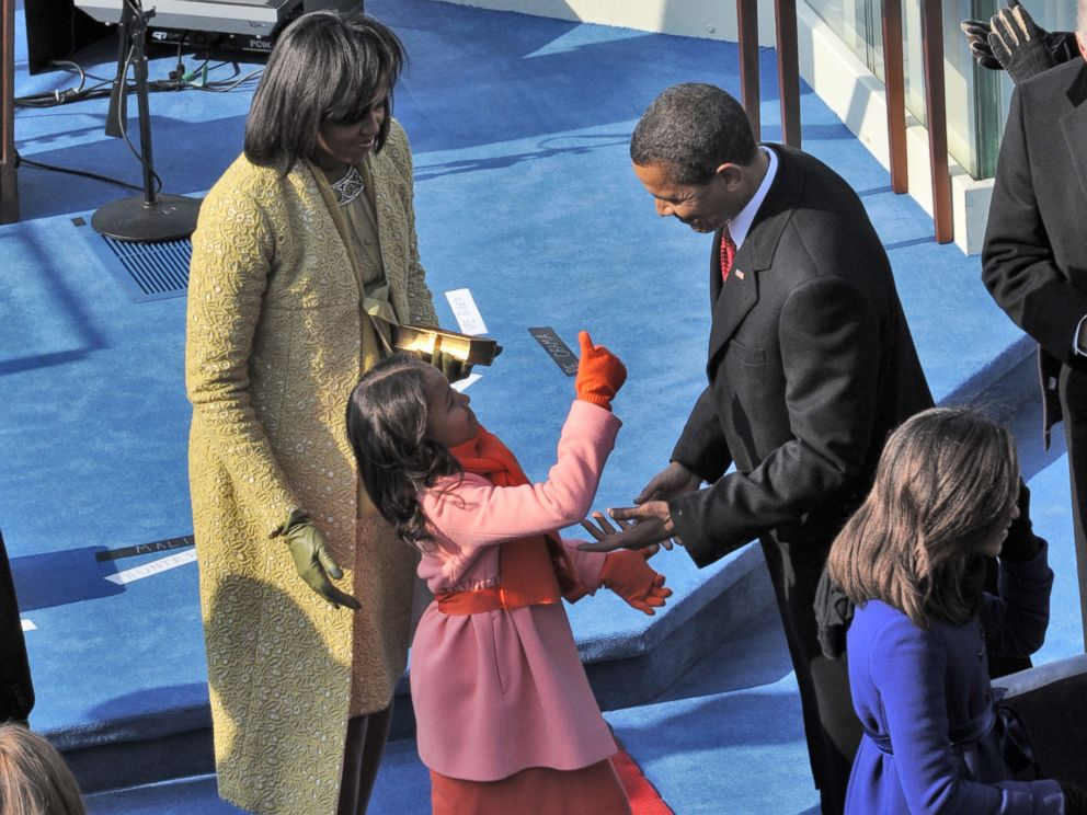 PHOTO: Sasha Obama gives her father a thumbs up after he takes the oath of office, Jan. 20, 2009. Her mother, Michelle, is at left and her sister, Malia, is at right.
