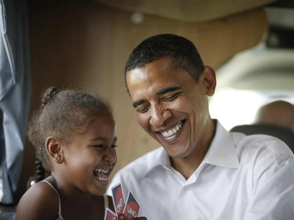 PHOTO: Democratic presidential hopeful Senator Barack Obama, D-IL, his wife Michelle and two daughters Sasha (6) and Malia (9) play cards in their RV, July 4, 2007 on a campaign swing between Oskaloosa and Pella, Iowa.