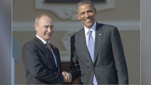 PHOTO: In this handout image provided by Host Photo Agency, Russian President Vladimir Putin (L) greets U.S. President Barack Obama at the G20 summit, Sept. 5, 2013 in St. Petersburg, Russia.