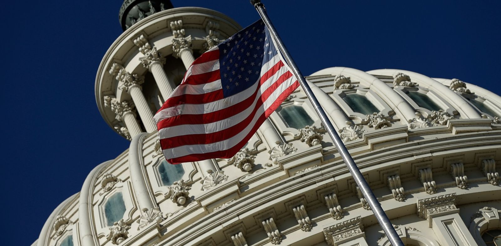 PHOTO: An American flag waves outside the United States Capitol building as Congress remains gridlocked over legislation to continue funding the federal government Sept. 29, 2013 in Washington.