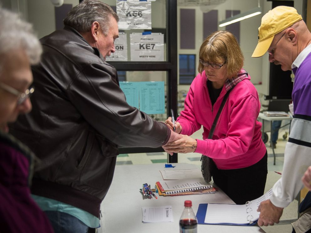 PHOTO: Caucus workers check-in voters prior the Republican Party Caucus at Keokuk High School, Feb, 1, 2016 in Keokuk, Iowa.