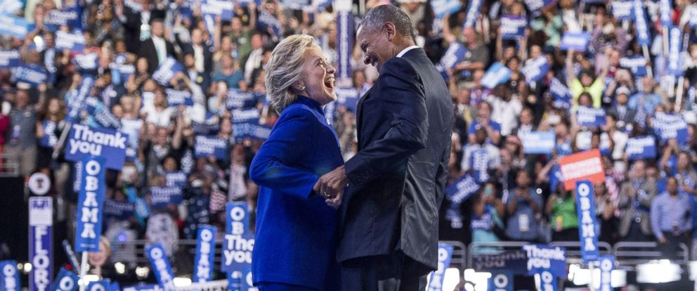 PHOTO: President Barack Obama is joined by US Democratic presidential candidate Hillary Clinton after his address to the Democratic National Convention at the Wells Fargo Center in Philadelphia, July 27, 2016.