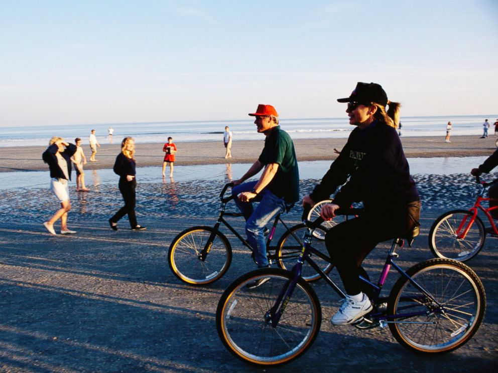 PHOTO:In this undated file photo Bill Clinton and Hillary Rodham Clinton ride bicycles along the beach at Hilton Head in South Carolina.