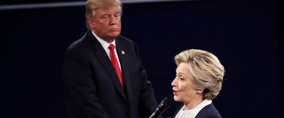 PHOTO: Hillary Clinton speaks as Donald Trump looks on during the town hall debate at Washington University, Oct. 9, 2016, in St Louis.