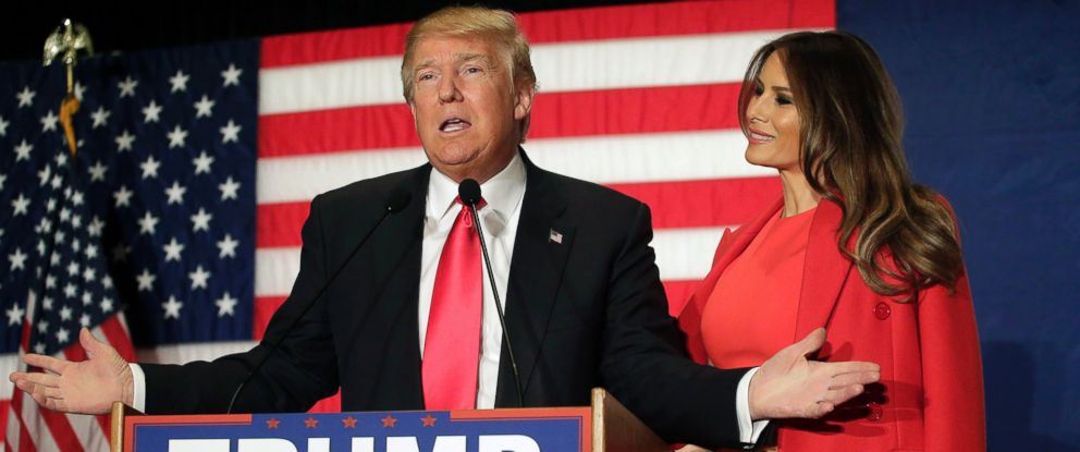 PHOTO: Republican presidential candidate Donald Trump speaks with his wife Melania Trump by his side during a campaign event at the U.S. Cellular Convention Center, Feb. 1, 2016 in Cedar Rapids, Iowa.