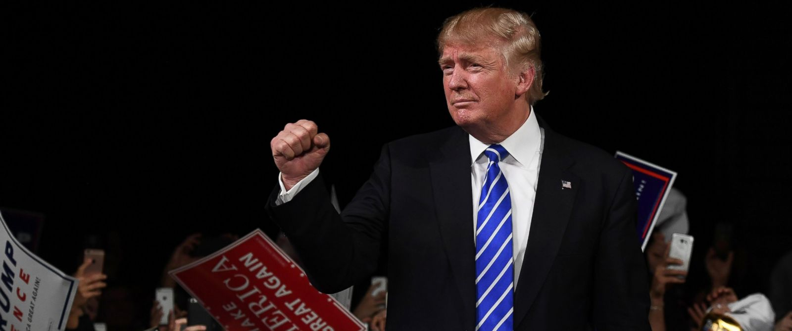 PHOTO: Republican presidential nominee Donald Trump greets supporters during a campaign rally at the Suburban Collection Showplace in Novi, Michigan, Sept. 30, 2016.