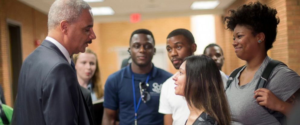 PHOTO: Attorney General Eric Holder shakes hands with Bri Ehsan, right, following his meeting with students at St. Louis Community College Florissant Valley, Aug. 20, 2014, in Ferguson, Missouri.