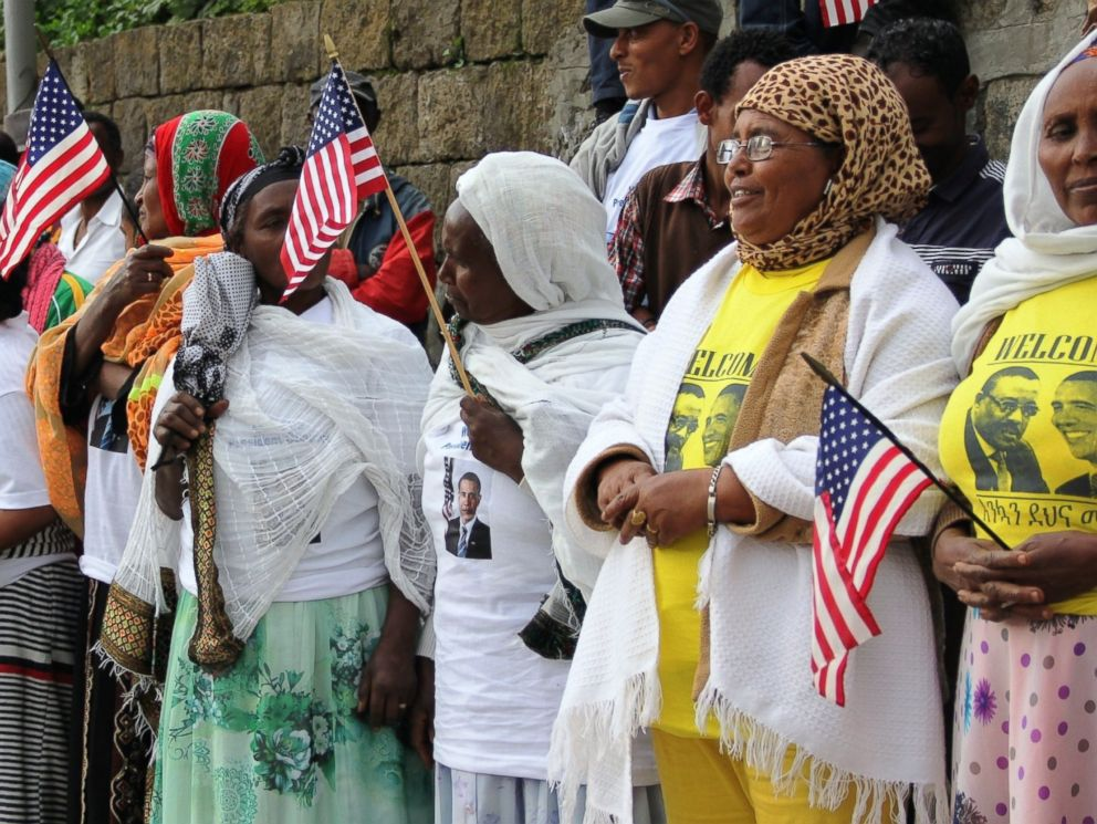 PHOTO: Ethiopians hold US flags as they waiting at Meskel Square prior to the official visit of President Barack Obama, July 26, 2015, in Addis Ababa, Ethiopia.