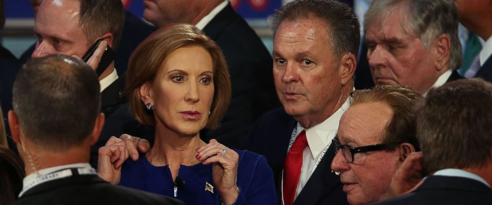 PHOTO: Republican presidential candidate Carly Fiorina walks with her husband Frank Fiorina at the presidential debate at the Reagan Library, Sept. 16, 2015 in Simi Valley, Calif.