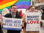 PHOTO: Spencer Geiger, left, and Carl Johansen protest for equal marriage outside the Walter E. Hoffman U.S. Courthouse as oral arguments in the case of Bostic v Rainey proceed on Feb. 4, 2014 in Norfolk, Va.