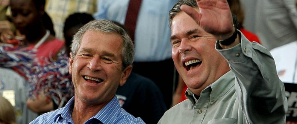 PHOTO: Former President George W. Bush and his brother Jeb Bush smile while greeting supporters during a campaign rally at Progress Energy Park in this Oct. 19, 2004 file photo in St. Petersburg, Fla
