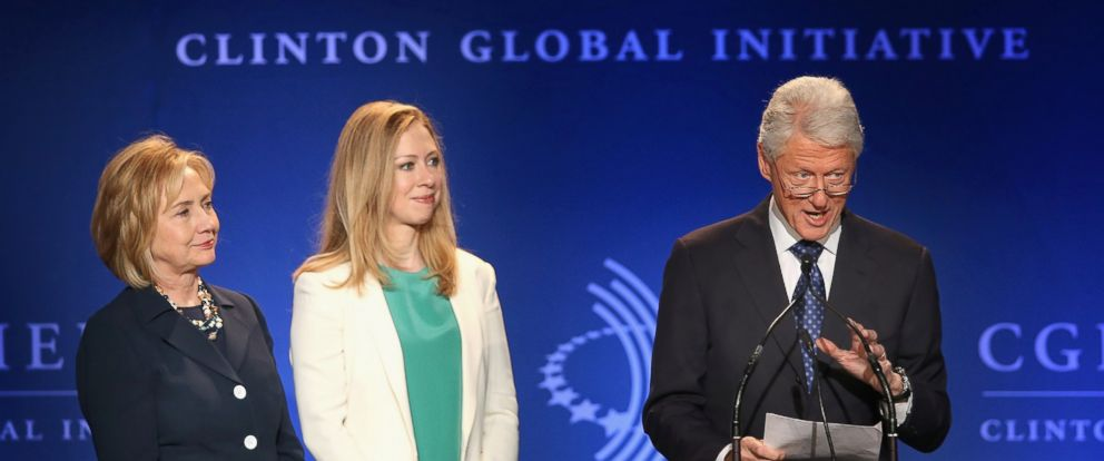 PHOTO: Former President Bill Clinton, his wife Former Secretary of State Hillary Clinton (L) and their daughter Chelsea Clinton speak to guests at the Clinton Global Initiative (CGI) on June 14, 2013 in Chicago.