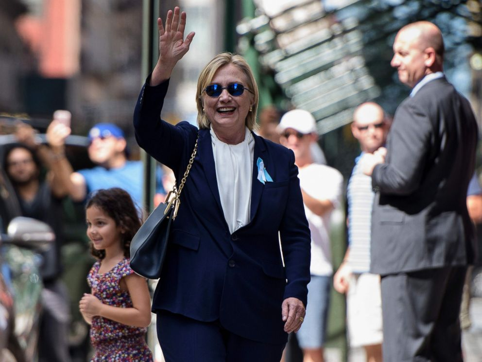 PHOTO: Democratic presidential nominee Hillary Clinton waves to the press as she leaves her daughters apartment building after resting on Sept. 11, 2016, in New York.
