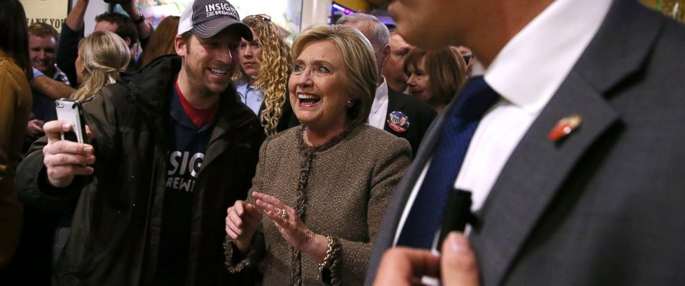 PHOTO: Democratic presidential candidate former Secretary of State Hillary Clinton greets patrons at City Center World Market on March 1, 2016 in Minneapolis.