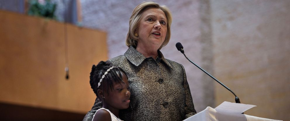 PHOTO: Democratic presidential nominee Hillary Clinton stands with Zianna Oliphant, age 9, while speaking during a Sunday service at Little Rock AMC Zion Church in Charlotte, North Carolina, Oct. 2, 2016.