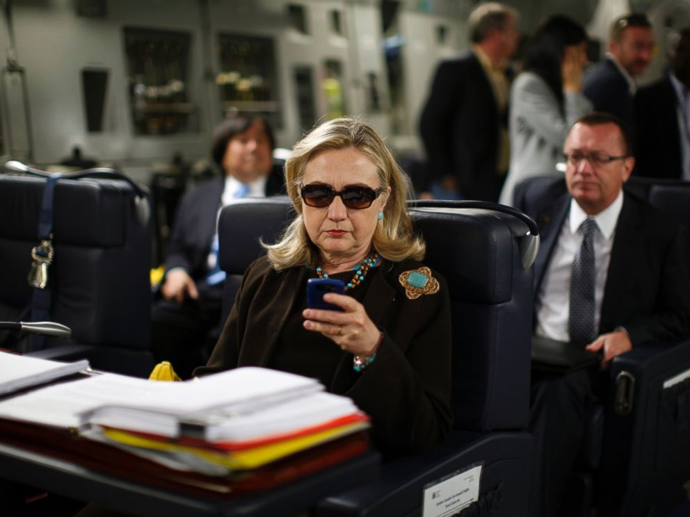PHOTO: U.S. Secretary of State Hillary Clinton checks her PDA upon departure in a military C-17 plane from Malta bound for Tripoli, Oct. 18, 2011.