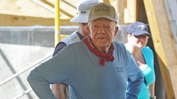 PHOTO: Jimmy Carter helps build a house as he visits the construction site of houses being built by Carters Habitat for Humanity foundation for victims of the Jan. 2010 earthquake in Leogane, 33km south of Port-au-Prince, Haiti on Nov. 26, 2012.