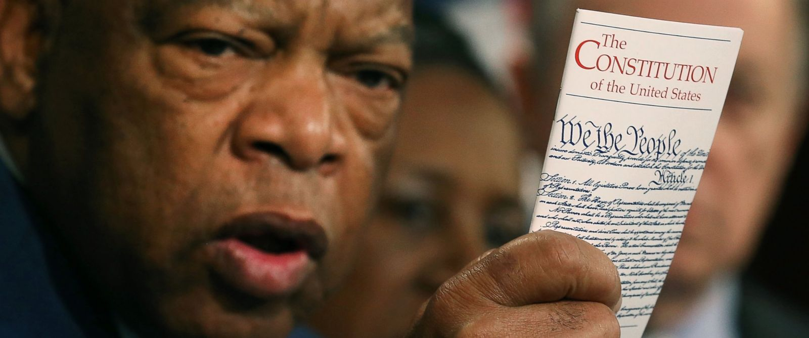 PHOTO: Rep. John Lewis holds a copy of the U.S. Constitution during a news conference with Senate Democrats and members of the Congressional Black Caucus, on Capitol Hill, March 3, 2016 in Washington.
