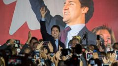 PHOTO: Canadian Liberal Party leader Justin Trudeau arrives on stage in Montreal on Oct. 20, 2015, after winning the general elections.