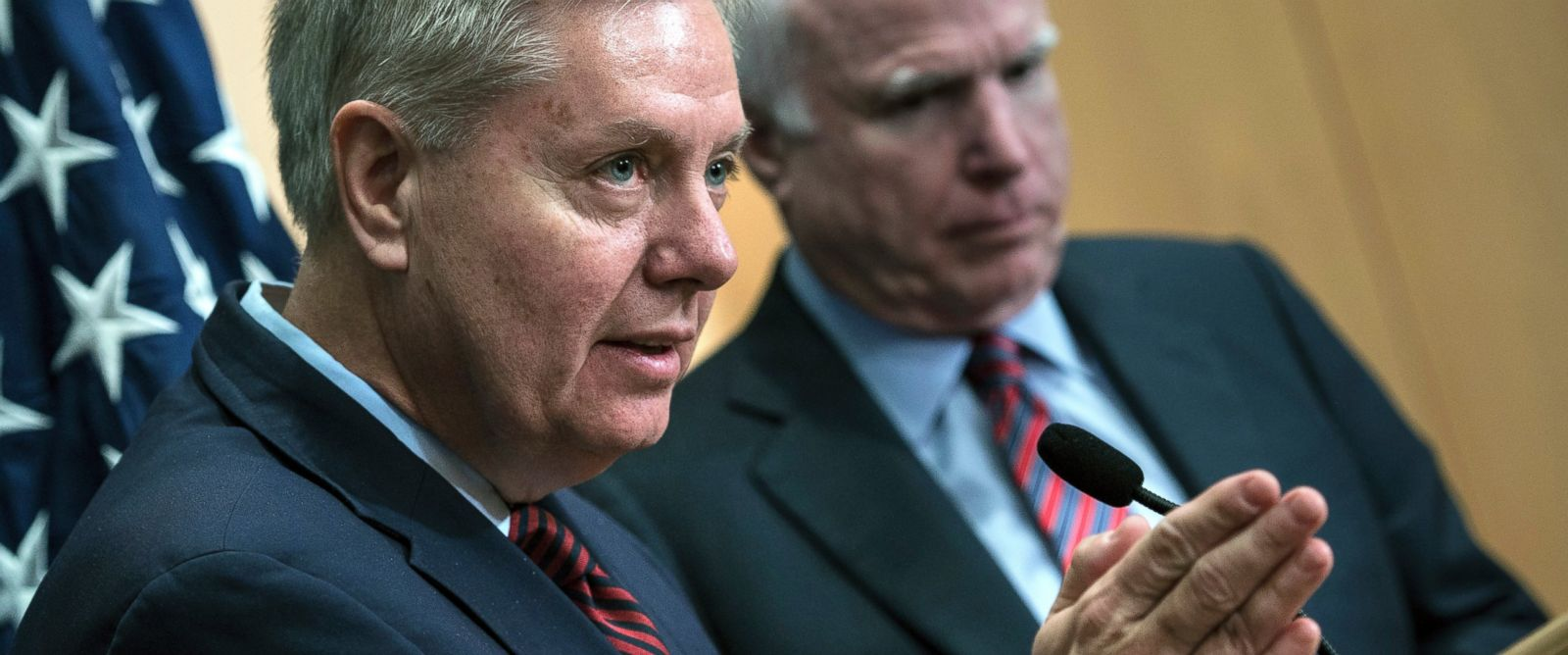 PHOTO: Senator Lindsey Graham speaks near Senator John McCain during a press conference at the David Citadel hotel, Jan. 3, 2014, in Jerusalem.