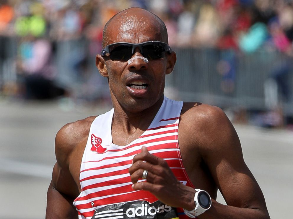 PHOTO: Mens winner Mebrahtom Keflezighi runs past Mile 18 in Newton during the 118th Boston Marathon, April 21, 2014.