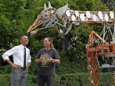 President Obama Tickles a Giant Robotic Giraffe