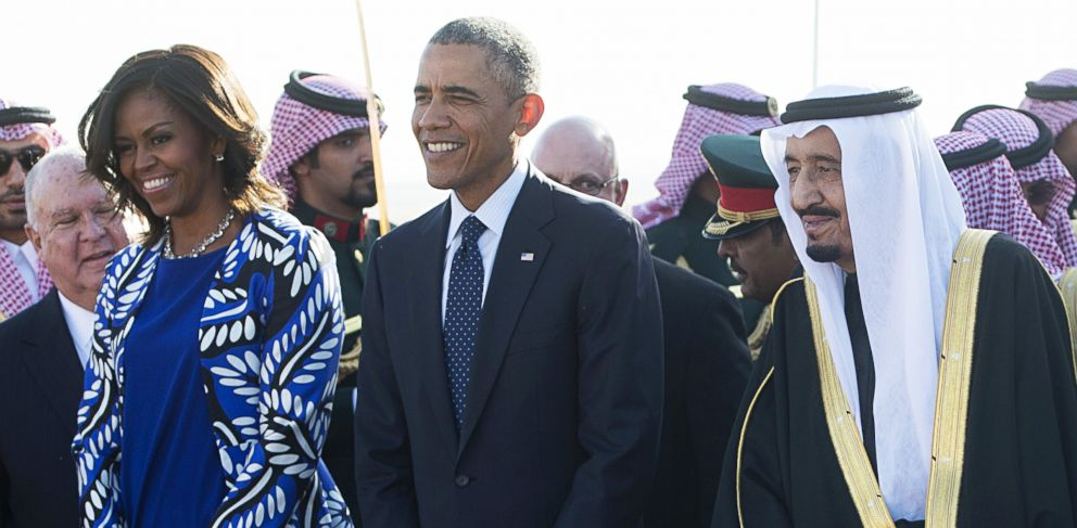 PHOTO: Saudi new King Salman, right, walks alongside President Barack Obama and first lady Michelle Obama after the Obamas arrived on Air Force One at King Khalid International Airport in Riyadh on Jan. 27, 2015.