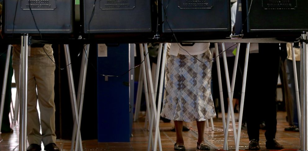 PHOTO: Voters fill out their ballots during the early voting period at a voting station