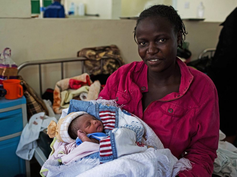PHOTO: Millicent Akinyo holds her new born baby girl, named Michelle in honor of US First Lady Michelle Obama, at the Mbagathi Hospital in Nairobi on July 26, 2015.