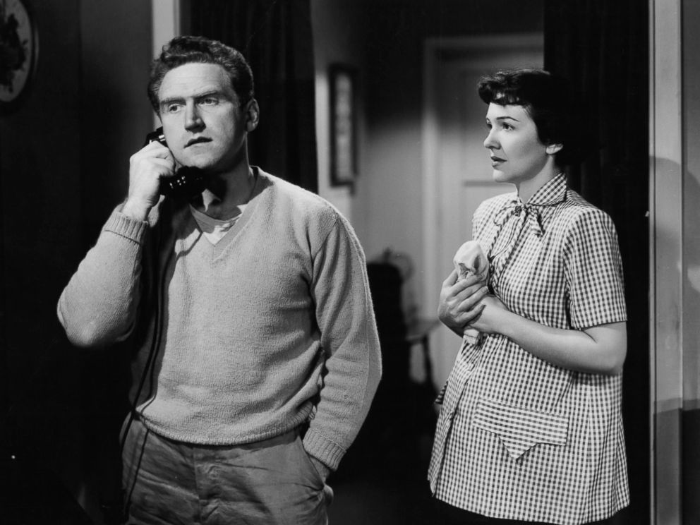 PHOTO:James Whitmore on the phone as Nancy Davis watches in a scene from the film The Next Voice You Hear..., 1950.