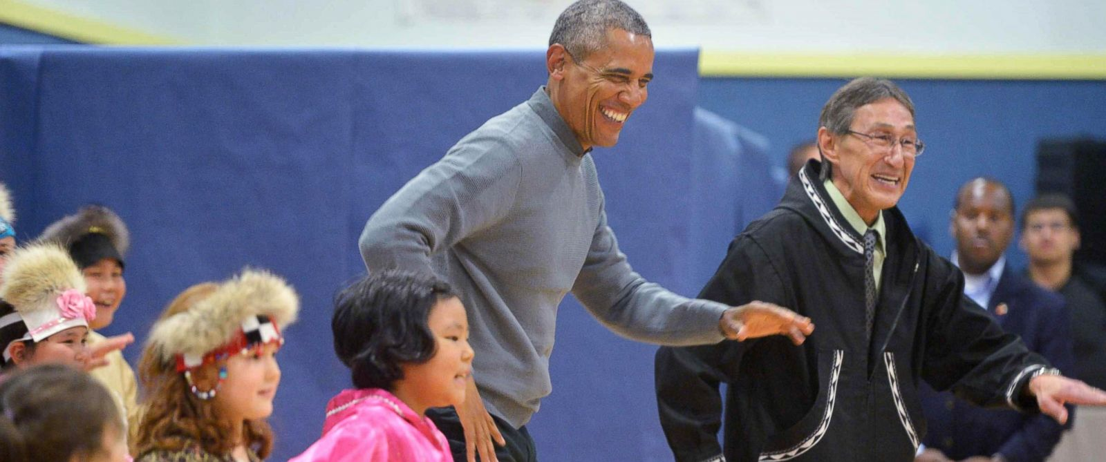 PHOTO: President Barack Obama dances with children after attending a cultural performance in Dillingham Middle School in Dillingham, Alaska, Sept. 2, 2015.