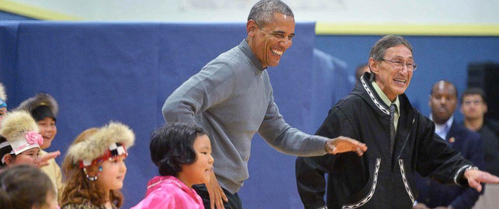 PHOTO: President Barack Obama dances with children after attending a cultural performance in Dillingham Middle School in Dillingham, Alaska, Sept. 2, 2015.