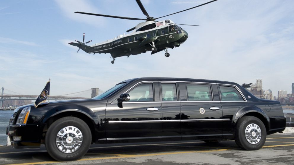 PHOTO: Marine One helicopter, carrying Barack Obama, prepares to land next to the Presidential limousine, known as The Beast, at the Wall Street landing zone in New York City on March 11, 2014.