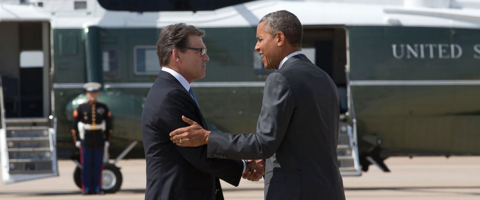 PHOTO: Texas Gov. Rick Perry greets President Barack Obama as he arrives at Dallas/Fort Worth International Airport, July 9, 2014.