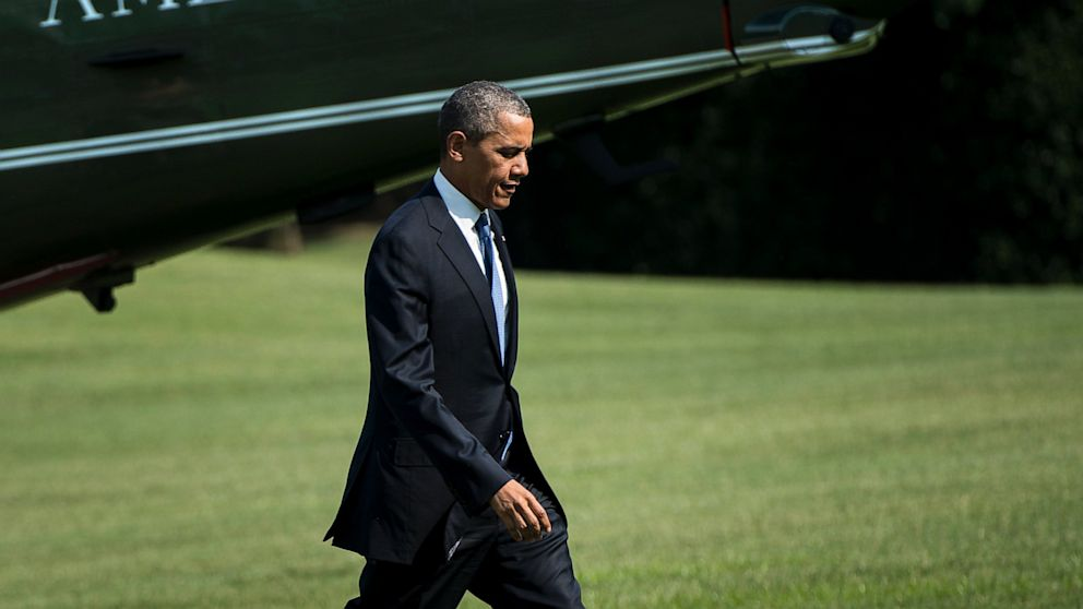 PHOTO: President Barack Obama walks from Marine One on the South Lawn of the White House, July 30, 2013, in Washington.