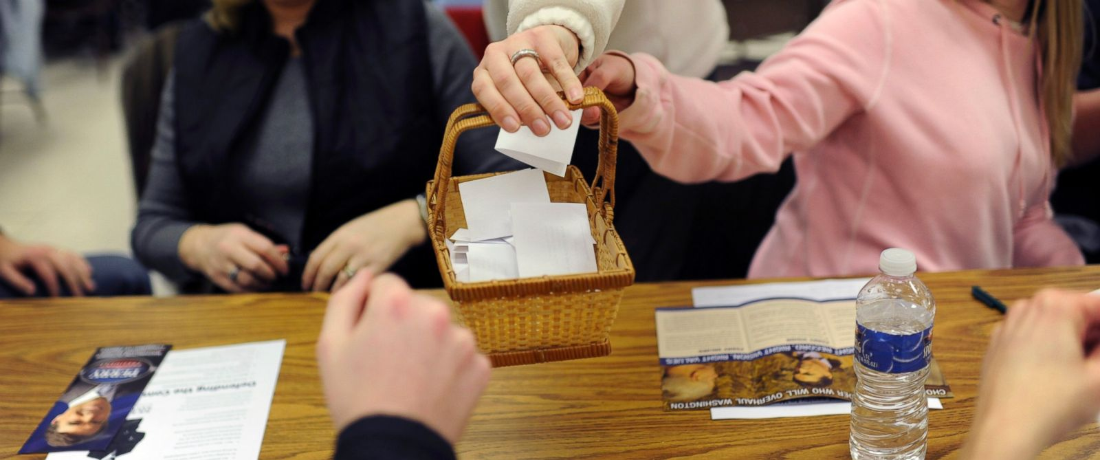 PHOTO: Caucus participants place their votes in a basket during the Precinct 7 caucus in Rock Rapids, Iowa, Jan. 3, 2012.